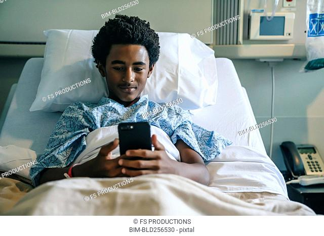 Blackboard texting on cell phone in hospital bed