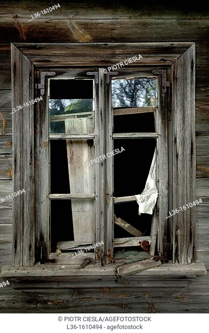 A window from a old abandoned farm house in Poland