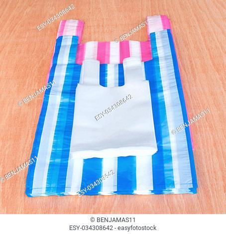 Plastic bags on the wooden floor