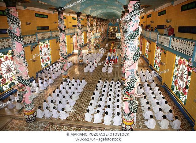 Caodai Great Temple, prayers. Tay Ninh. Vietnam