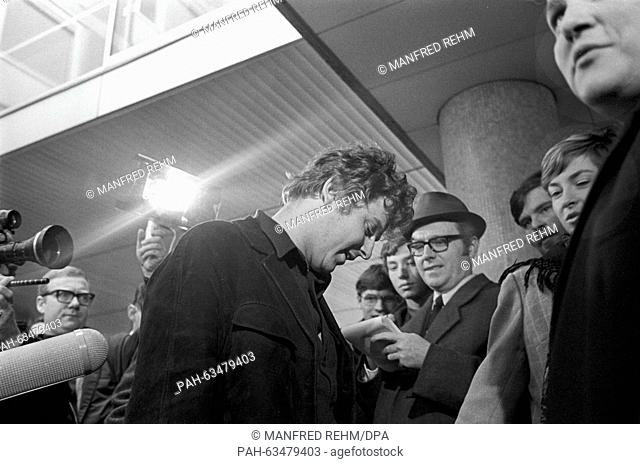 Student leader Daniel Cohn-Bendit leaves Frankfurt district court on 24 January 1969. He received a sentence on probation of six months because of riot and...