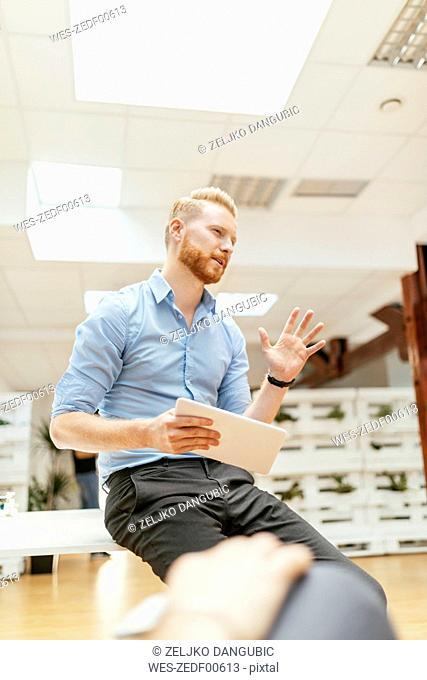 Businessman holding tablet during presentation