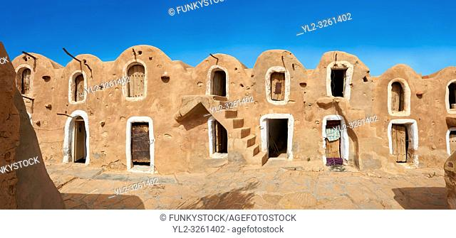 The northern Sahara ghorfa storage graneries of the traditional Berber mud brick fortified Ksar of Hedada or Hadada, near Tetouin, Tunisia