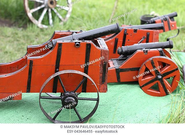 Miniature antique vintage artillery gun with wooden base and metal barrel