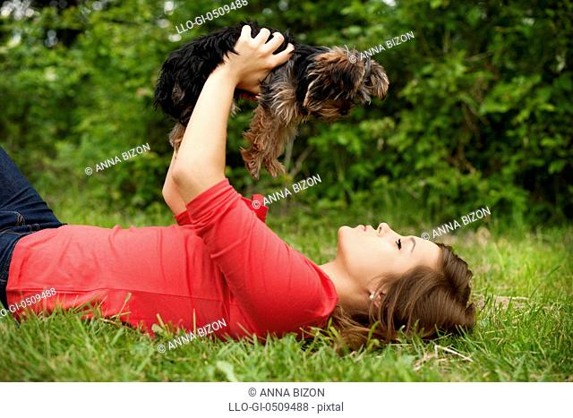 Young woman holding cute puppy Debica, Poland