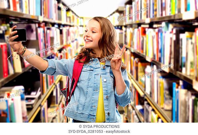 teenage student girl taking selfie by smartphone