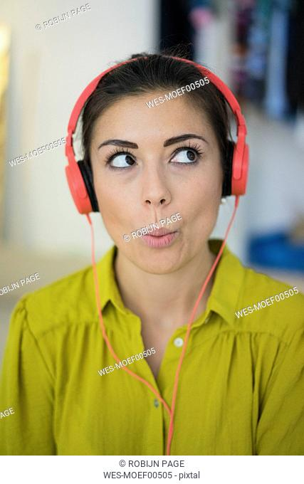Portrait of womanlistening music with headphones