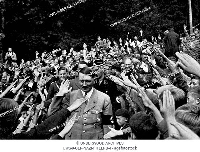 Obersalzberg, Germany: c. 1934.Adolph Hitler being greeted at his summer home, the Berghof in the Bacarian Alps