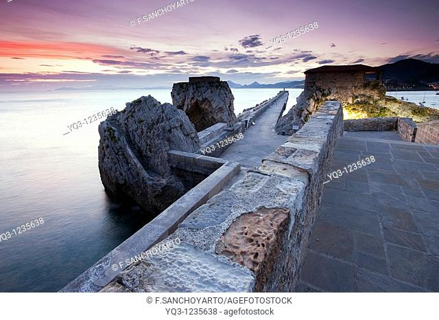 View of sunrise from the medieval bridge of Castro Urdiales, Cantabria, Spain