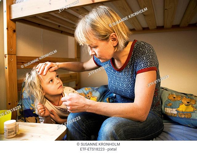 Mother taking care of sick daughter, Sweden