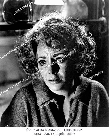 Elisabeth Taylor, in a close up, crying in a scene of the movie Who's Afraid of Virginia Woolf?; her interpretation of Martha, George's wife