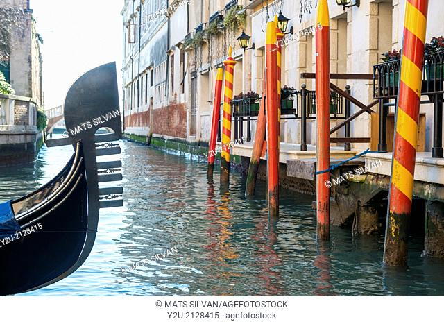 Gondola and colorful logs in Venice Italy