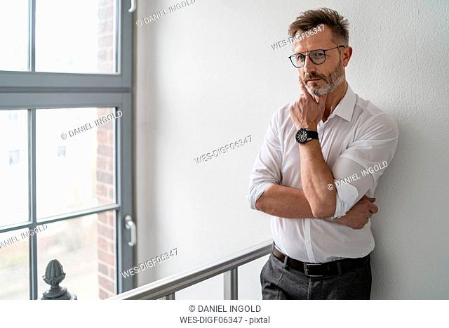 Portrait of businessman at the window in office