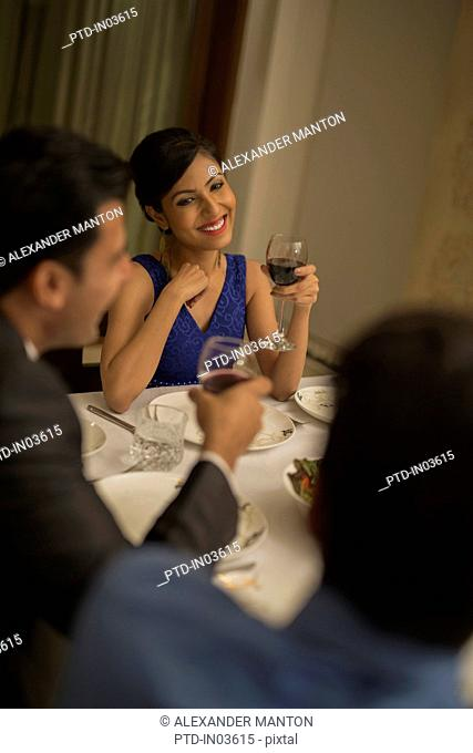 Woman at formal dinner with wine glass
