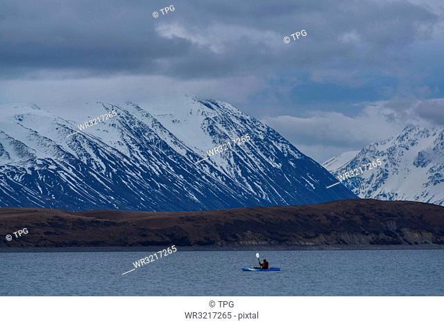 People travel though Lake Tekapo;New Zealan