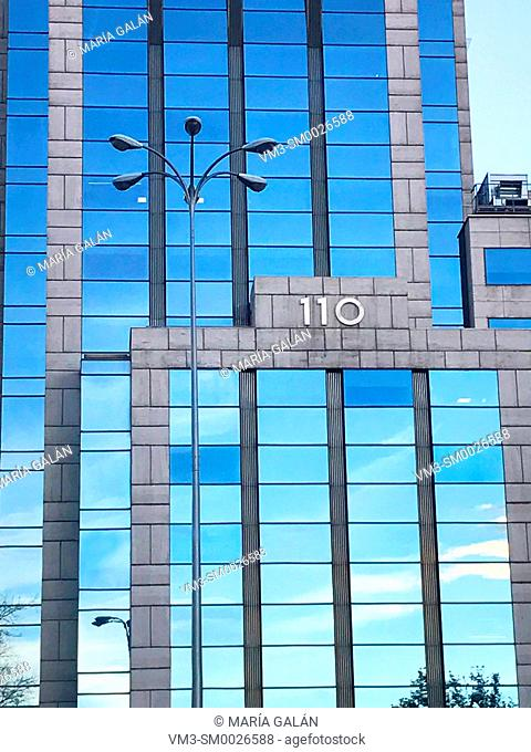 Glass facade of modern building. Plaza de Castilla, Madrid, Spain