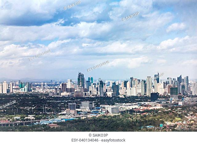 MANILA, PHILIPPINES - FEBRUARY 24: Makati skyline on February, 24, 2013, Manila, Philippines. Makati is a financial centre of Manila city with highest building...