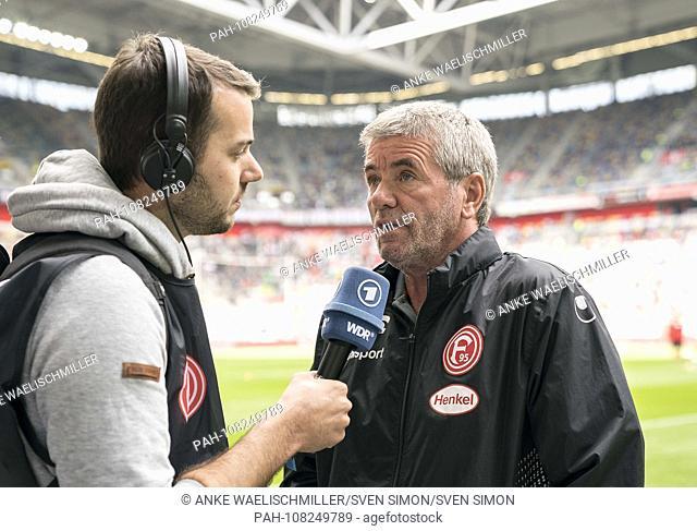 Coach Friedhelm FUNKEL (D) speaks into a microphone, radio, interview, WDR, ARD. Soccer 1.Bundesliga, 1.matchday, Fortuna Dusseldorf (D) - FC Augsburg (A) 1: 2