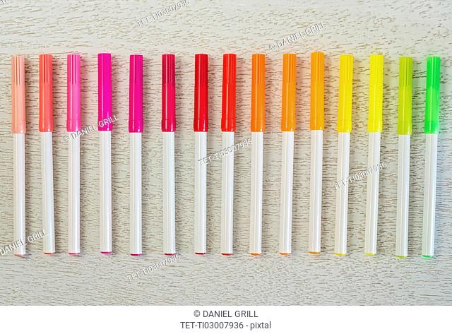 Multi colored felt tip pens in a row
