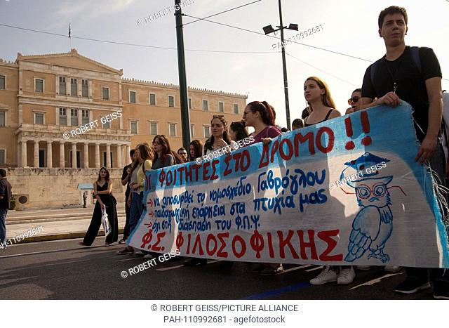 """Greek students protest in front of Parliament against austerity measures in education sector. Writing """"""""Students on the streets"""""""""""