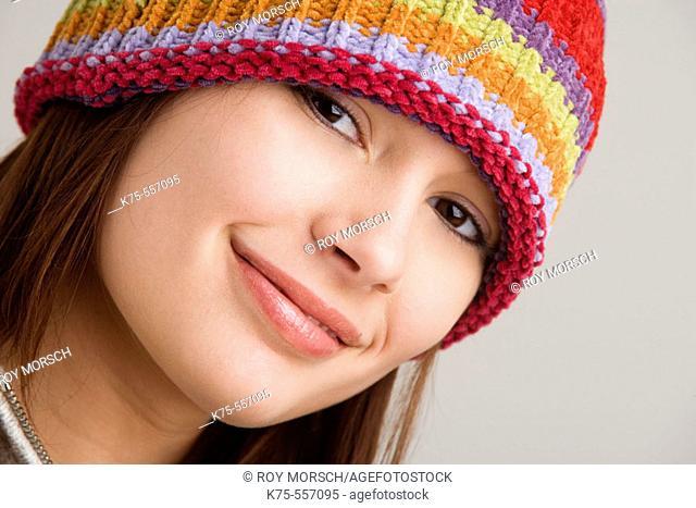 Portrait of caucasian-hispanic woman in her twenties with cap