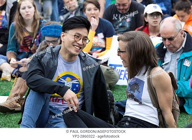 Seattle, Washington: A young couple talk at the rally in Cal Anderson Park. The March for Science Seattle was a non-partisan rally and sister march to the...