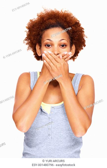 Speak no evil - Beautiful woman covering mouth with her hand while over white background