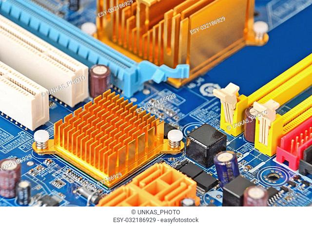 Printed computer motherboard with microcircuit, close up, DOF