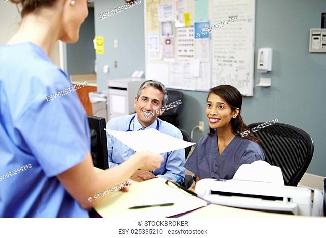 Medical Staff Meeting At Nurses Station
