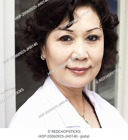 Close-up of a female doctor smiling
