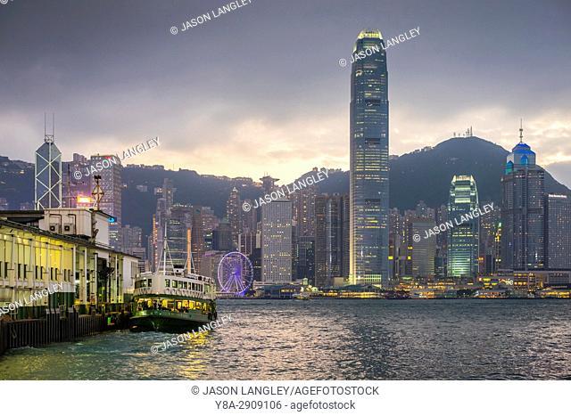 Hong Kong skyline and Star Ferry Pier at dusk, Tsim Sha Tsui, Kowloon, Hong Kong, China