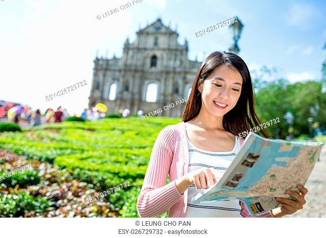 Woman using city map in Macau city