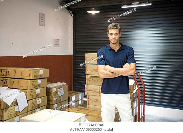 Man in warehouse, portrait