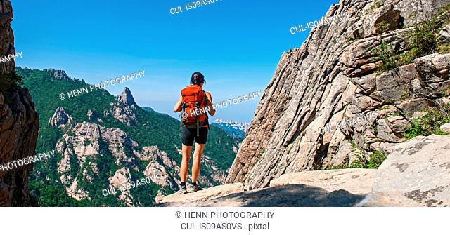 Female hiker walking along a ridge at Seoraksan National park, Gangwon, South Korea