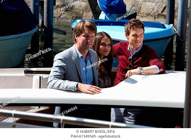 Director Tom Hooper, Alicia Vikander and Eddie Redmayne (r) arrive by boat for the press conference of The Danish Girl during the 72nd Venice Film Festival at...