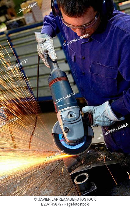 Rough grinding, forging, metalworking process, grinding machine with abrasive wheel, metallurgy, Legazpi, Gipuzkoa, Euskadi, Spain