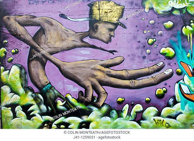 Street art, graffiti, adorns roadside wall, New Plymouth, taranaki