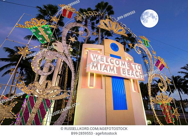 CHRISTMAS DECORATIONS WELCOME TO MIAMI BEACH SIGN TUTTLE CAUSEWAY MIAMI BEACH FLORIDA USA