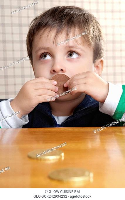 Close-up of a boy eating cookies