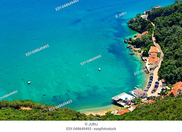 Summer sea coastal landscape with Portinho beach parking. Top view from Nature Park of Arrabida in Setubal, Portugal