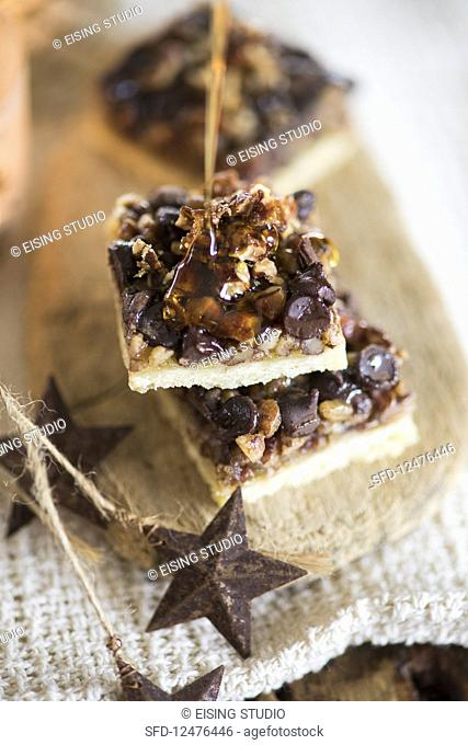 chocolate and nut slices with caramel