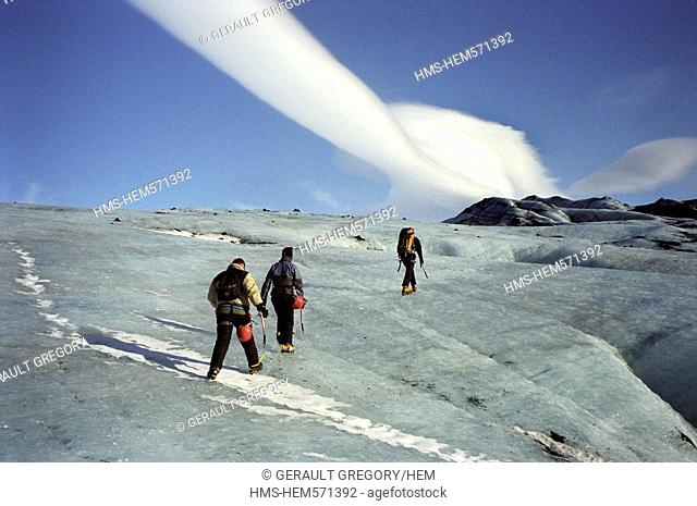 Iceland, Sudurland Region, walking with crampons on the ice tongue of Solheimajokull, belonging to the Glacier Myrdalsjokull