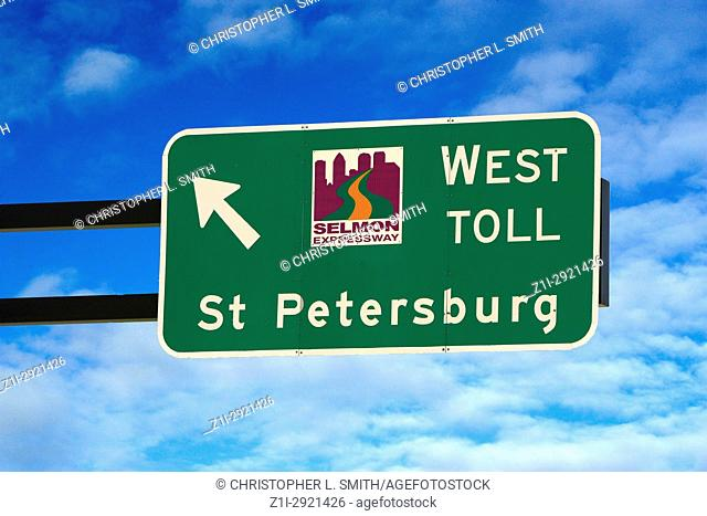 Overhead sign pointing to St. Petersburg via the Selmon Expressway in Tampa FL, USA