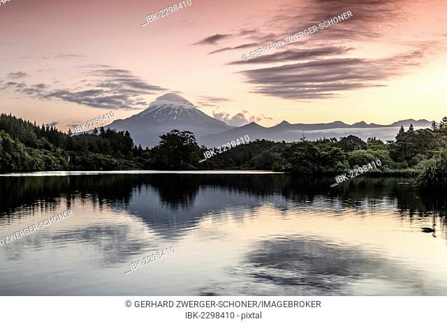 Currently inactive volcano, Mt Egmont, Mt Taranaki, reflections in Lake Mangamahoe reservoir, dam, North Island, New Zealand