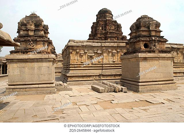The Subrahmanya shrine on the left, the main sanctum in the centre and another shrine on the left side, Krishna Temple, Hampi, Karnataka, India