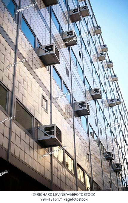 Air conditioners sprout from windows in a building in New York Attractive pricing and smuggling of the illegal coolant HCFC-22 freon is making it difficult to...