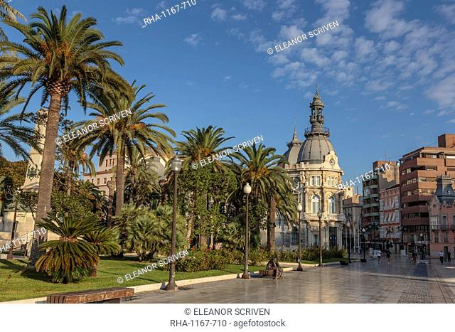 Town Hall under a cloud dappled blue sky with palm trees and roses, Cartagena, Murcia Region, Spain, Europe