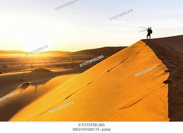 Namibia, Namib Desert, Namib Naukluft National Park, photographer standing on dersert dune