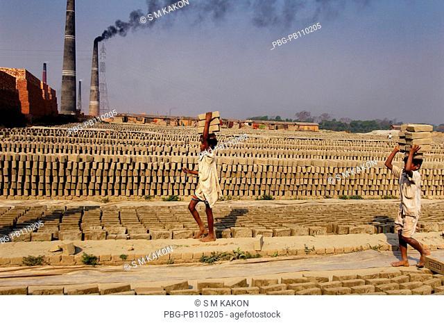 Child workers carry bricks at Fatullah Narayanganj, Bangladesh