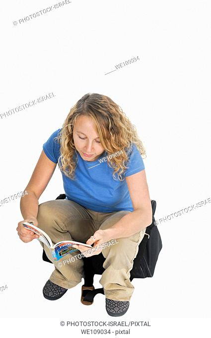 young traveler consults a guidebook On white Background